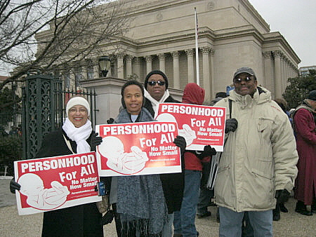 African-Americans at the March for Life, Washington, D.C., with signs that say, 'Personhood for All'