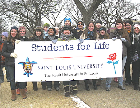 St. Louis University students with their Students for  Life banner