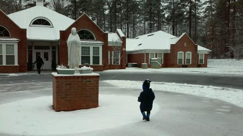 Toddler in the snow, in front of MiraVia residence