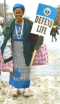 Woman with 'Defend Life' sign