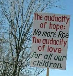 Sign at March for Life--'The audacity of hope: <em>No more Roe</em>/The audacity of love <em>for all our children.</em>'