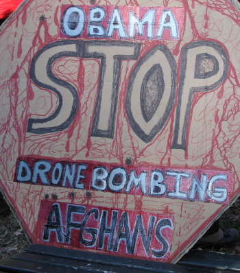 Sign says: 'Obama Stop Drone Bombing Afghans'