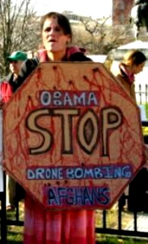 Woman with sign,  'Obama/Stop Drone Bombing Afghans'