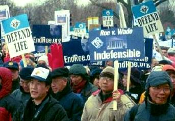 Anti-<em>Roe</em> and 'Defend Life' marchers and signs