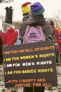 Activist at March for Life with sign proclaiming that  'I Am For' the Bill of Rights, women's rights, men's rights, and babies' rights