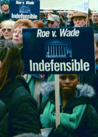 Demonstrators with signs: '<em>Roe v. Wade</em> Indefensible'