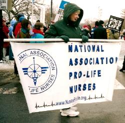 Nurse with banner: 'National Association of Pro-Life Nurses'