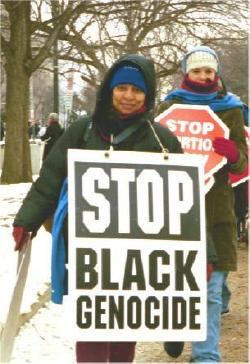 Woman at March for Life with sign:  'Stop Black Genocide'
