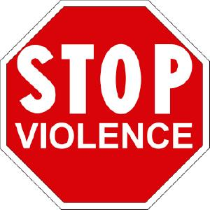 Large, white-on-red stop sign that says, 'STOP VIOLENCE'