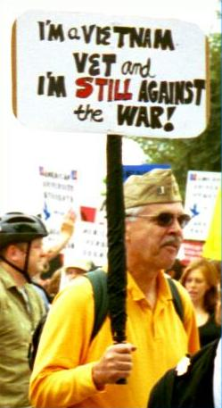 Man with sign at antiwar march:  'I'm a Vietnam Vet and I'm <strong>Still</strong> Against the War!'