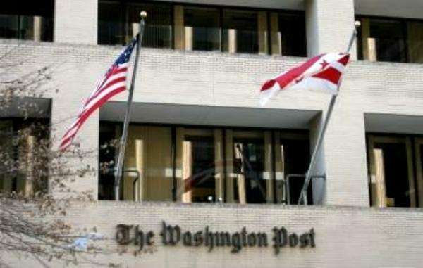The <em>Washington Post</em> building, with flags' flying