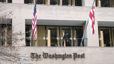 Flags fly at the <em>Washington Post</em> building, Washington, D.C.